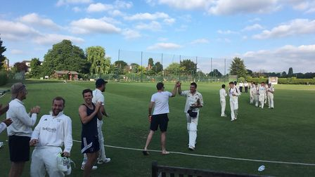 Brondesbury players congratulate Nick Jones after his century against Hornsey earlier in the season
