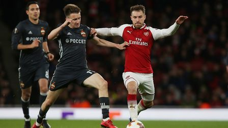 Aaron Ramsey of Arsenal vies with Aleksandr Golovin of CSKA Moscow in the UEFA Europa League game be