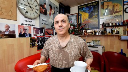 Hussein Jabar at Gadz Cafe in Finsbury Park. The cafe is decorated with Jeremy Corbyn tributes. Pict