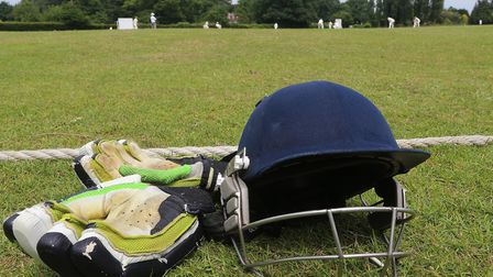 A cricket helmet and gloves lie beyond the boundary (pic George Phillipou/TGS Photo)