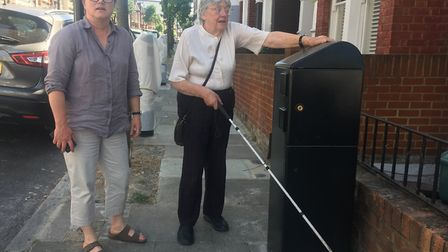 Cllr Caroline Russell and Jane with the offending charger in Battledean Road. Picture: Meera Pattni