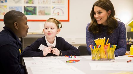 The Duchess of Cambridge talking to students at the officially opening of Place2Bes new home in Cle
