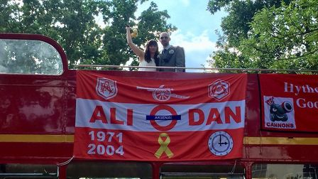 Danny Coyle and Ali Hawke on their Arsenal-themed routemaster bus on the Holloway Road