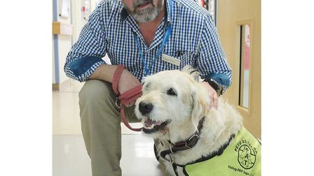 Dr Pike, Northwick Park Hospital's pet therapist, with owner consultant neonatal paediatrician Richa