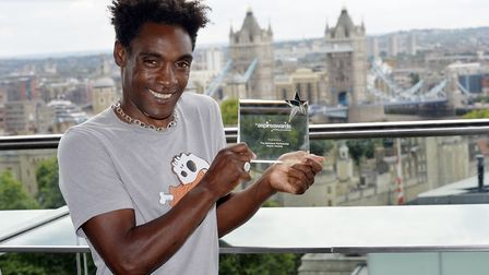 Stephen Griffith holding award from The Guinness Partnership