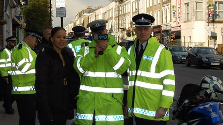 Cllr Claudia Webb with police officer at one of the first enforcement sessions for 20mph in Isling