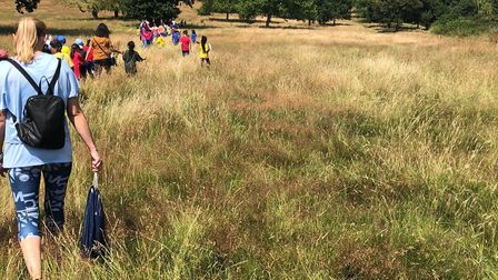 Children tackling the long grass on the way to their sports day. Picture: LAURA WARNER