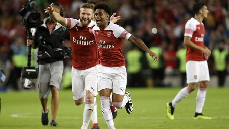 Arsenal's Shkodran Mustafi and Reiss Nelson celebrate victory during the pre-season friendly match a