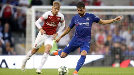 Arsenal's Emile Smith Rowe looks on as Chelsea's Cesc Fabregas plays a pass during the pre-season fr
