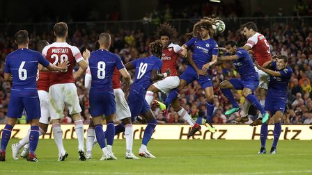 Arsenal's Mohamed Elneny and Chelsea's Ethan Ampadu battle for the ball during the pre-season friend