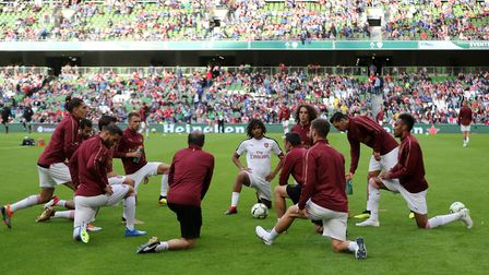 Aaron Ramsey warmed up with Arsenal team-mates before the pre-season friendly match at the Aviva Sta
