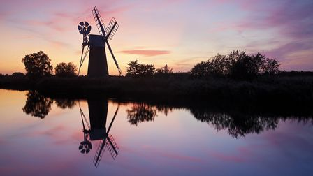 Turf Fen windmill at sunset on the River Ant, Norfolk Broads