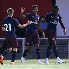 Tyreece John-Jules of Arsenal (C) scores the second goal for his team and celebrates with his team m