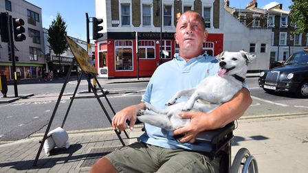 Daren Harrison and his dog Rosy, outside The Corner Flag pub on Hornsey Road. Picture: Polly Hancock