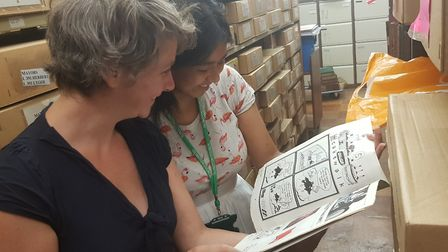 Alex Smith and Marlin Khondoker looking at treasures in the Islington's Pride archive. Picture: Isil