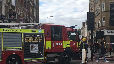 A fire engine outside the flat in Stroud Green Road this afternoon. Picture: Nathalie Raffray
