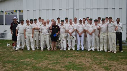 North London CC face the camera with a touring team from Victoria, Australia and Merv Hughes (back r