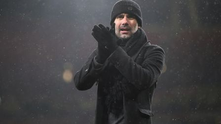 Manchester City manager Pep Guardiola applauds the fans after their Premier League win at Arsenal (p
