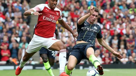 Arsenal's Pierre-Emerick Aubameyang (left) and Manchester City's Aymeric Laporte battle for the ball