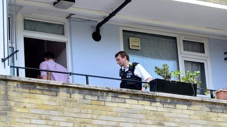 Police enter a flat in Papworth Gardens this morning. Picture: Polly Hancock