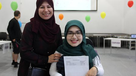 Fatima Ali with her mother, after she got her A* BB Grades confirmed today. She's set to study law a