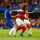 Arsenal's Matteo Guendouzi (right) and Chelsea's Pedro (left) battle for the ball during the Premier
