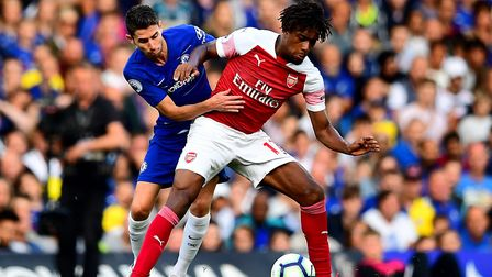 Chelsea's Jorginho (left) and Arsenal's Alex Iwobi (right) battle for the ball during the Premier Le