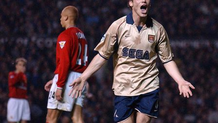 Freddie Ljungberg celebrates the strike by Sylvain Wiltord that won the Premier League for Arsenal a