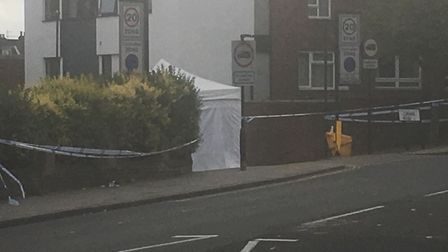 A police tent at the scene in Corinne Road, off Brecknock Road. Picture: Lucas Cumiskey