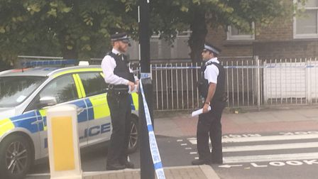 Police at the scene in Corinne Road, off Brecknock Road. Picture: Lucas Cumiskey