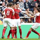 Arsenal's Granit Xhaka (centre) celebrates scoring his side's first goal of the game with team mates