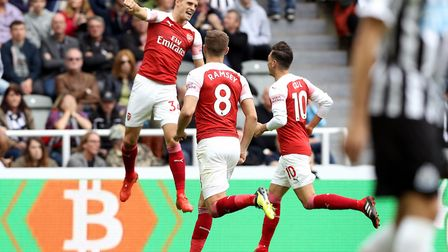 Arsenal's Granit Xhaka (left) celebrates scoring his side's first goal of the game with team mates d