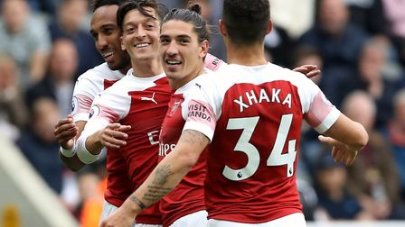 Arsenal's Mesut Ozil (second left) celebrates scoring his side's second goal of the game during the