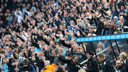 Newcastle United fans celebrate their victory against Arsenal last season at St James' Park. PA