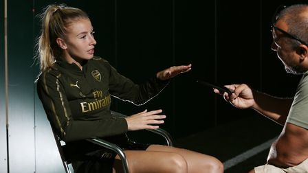 Arsenal and England's Leah Williamson speaks to Layth Yousif at their London Colney training ground.