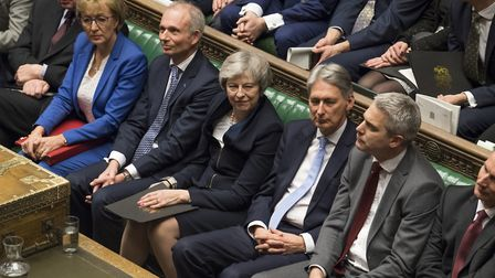 Theresa May sitting in the House of Commons after losing a vote on her Brexit plan. Photograph: UK P