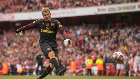 Arsenal Legends' Jens Lehmann scores the winning penalty in the penalty shootout during the Legends