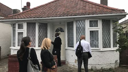 Brent Council's housing officers outside the house in Sudbury. Picture: Brent Council
