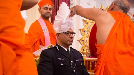 Met assistant commissioner Neil Basu has a white paagh tied during the Raksha Bandhan ceremony. Pict
