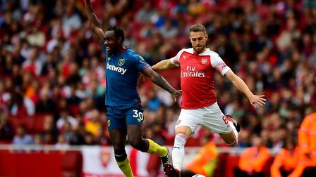 Arsenal's Aaron Ramsey and West Ham United's Michail Antonio battle for the ball during the Premier