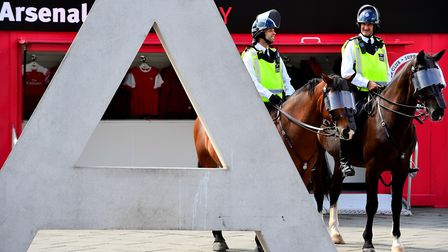 Mounted police outside the ground ahead of the Premier League match at the Emirates Stadium, London.