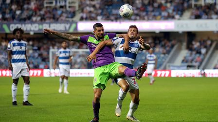Queens Park Rangers' Pawel Wszolek (right) battles for possession of the ball with Bristol City's Er