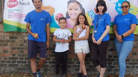 Cornwallis Adventure Playground staff (from left) Ben Bull, Jess Todd and Christina Henry with two L