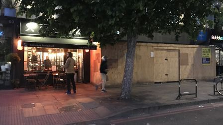 A hoarding is 'obscuring the outside seating area' at Tenshi resaurant in Upper Street. Picture: Joe
