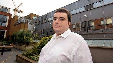 Resident Josh Yates stands on the communal terrace at 453 Calendonian Road, showing the former Scope
