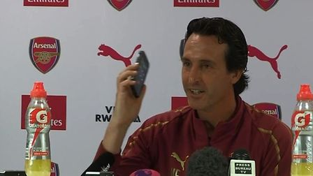 Arsenal reporter Layth Yousif's ringing mobile phone is answered by Arsenal head coach and good spor