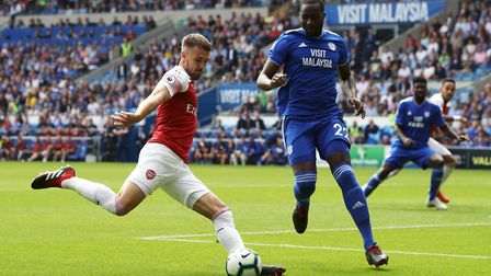Arsenal's Aaron Ramsey (left) and Cardiff City's Sol Bamba battle for the ball during the Premier Le