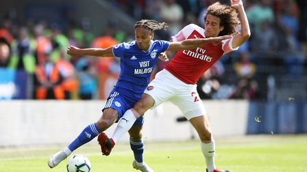 Cardiff City's Bobby Reid (left) and Arsenal's Matteo Guendouzi battle for the ball during the Premi