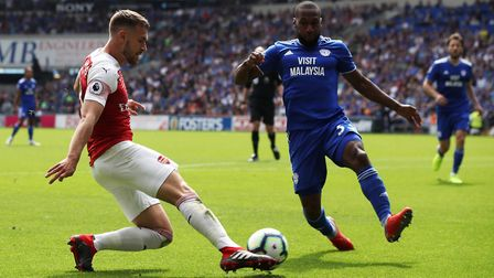 Arsenal's Aaron Ramsey (left) and Cardiff City's Junior Hoilett battle for the ball during the Premi