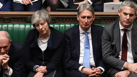 Theresa May and Phillip Hammond. Photograph: UK Parliament/Jessica Taylor/PA Wire